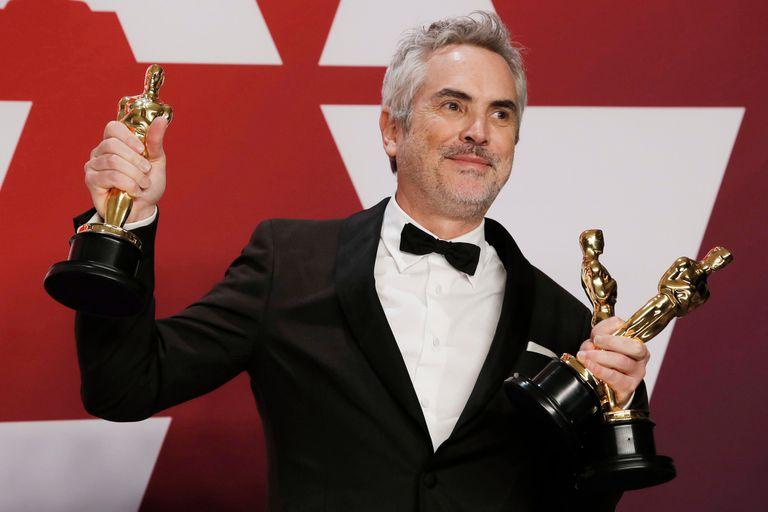 Alfonso Cuarón con sus tres premios