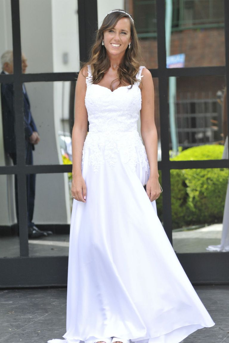 La novia posando para los flashes