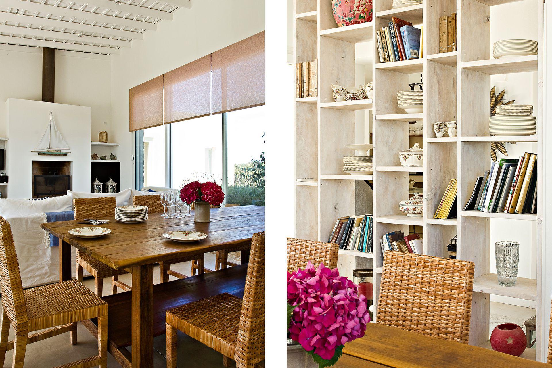 Para contrarrestar el blanco, cortinas de mimbre en color tostado. El mueble que marca una división sutil con su trama semitransparente y los de la cocina son obra del Estudio.