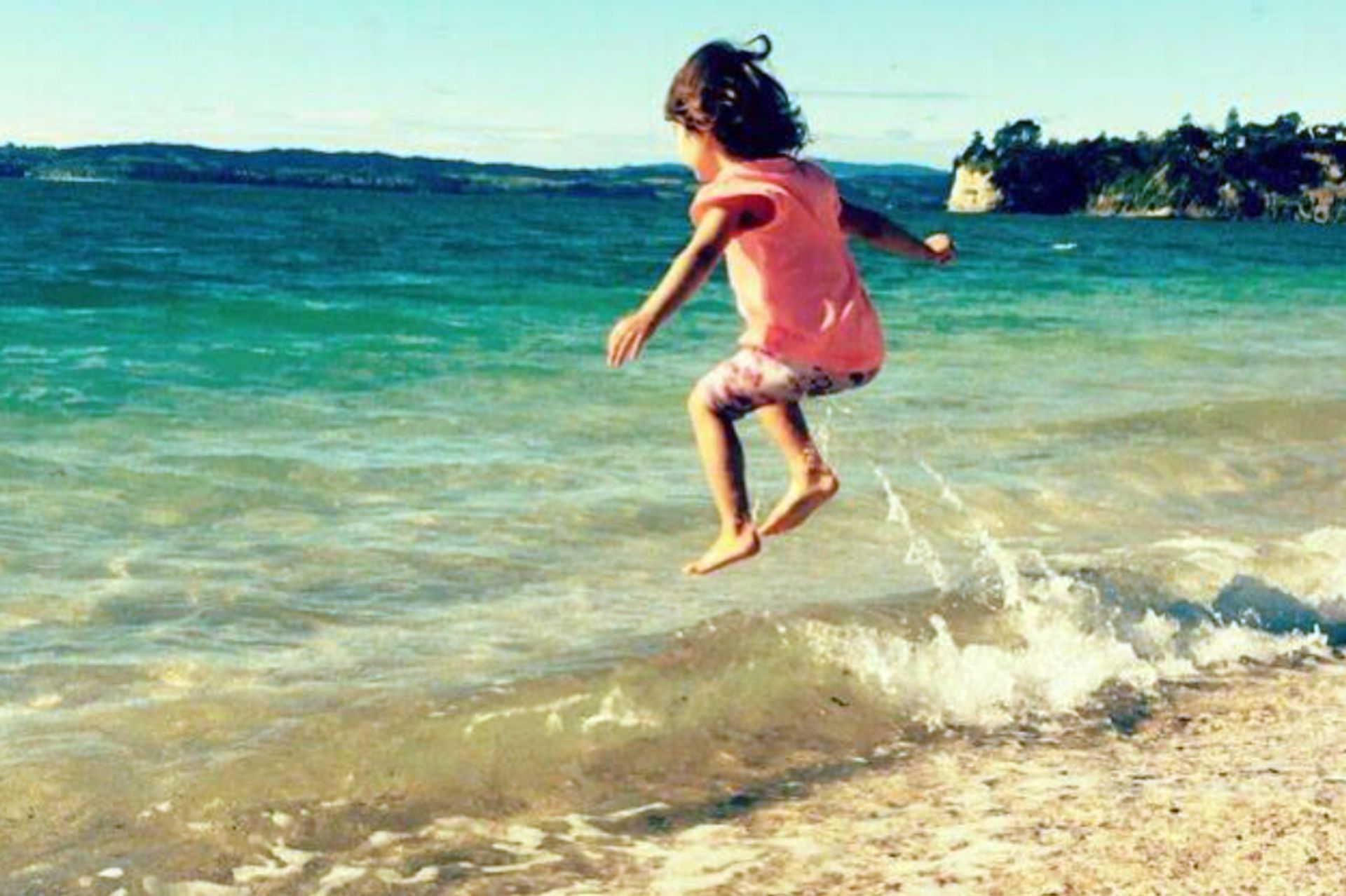 Feliz en la playa de casa.