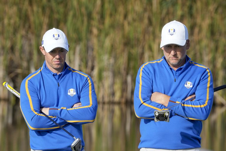 Team Europe's Rory McIlroy and Team Europe's Ian Poulter wait to putt on the fifth hole during a foursome match the Ryder Cup at the Whistling Straits Golf Course Friday, Sept. 24, 2021, in Sheboygan, Wis. (AP Photo/Charlie Neibergall)