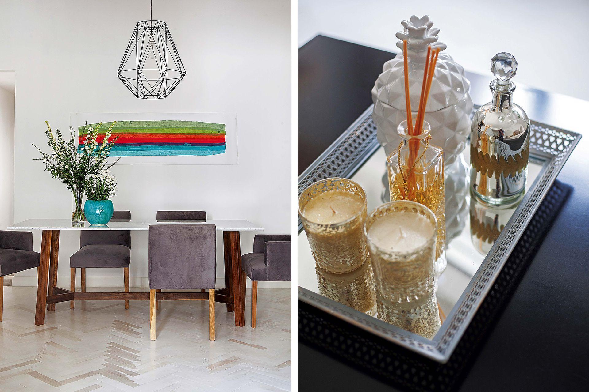 """Mesa (Estudio Trama) y sillas de pana (Coup), que se suman al living cuando hace falta. Lámpara geométrica (Flo's Market). Obra """"Aguayo""""', de Carlos Taquini."""