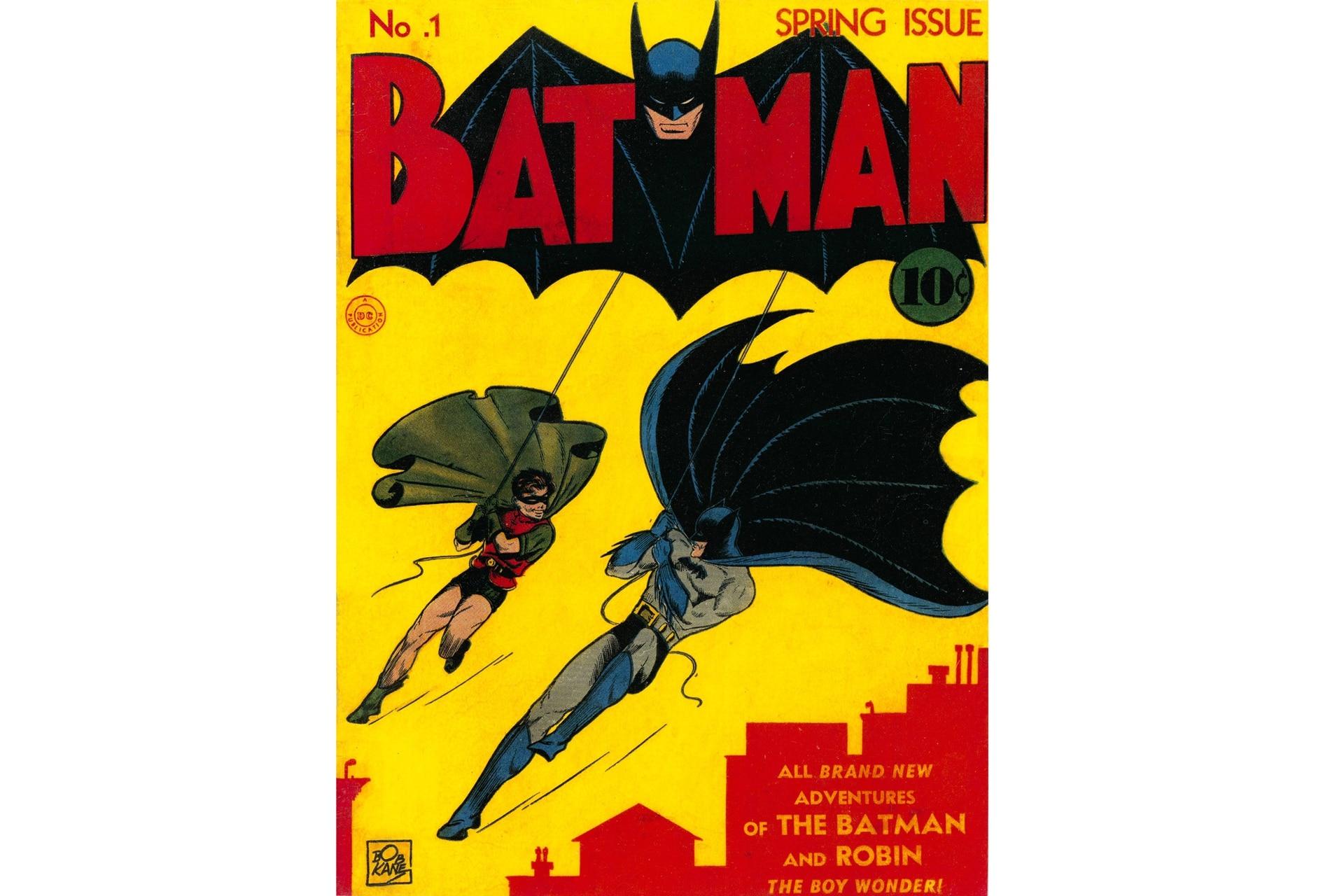 Batman obtiene su propia revista, donde debutan el Guasón y Gatúbela. Dibujo de Bob Kane.