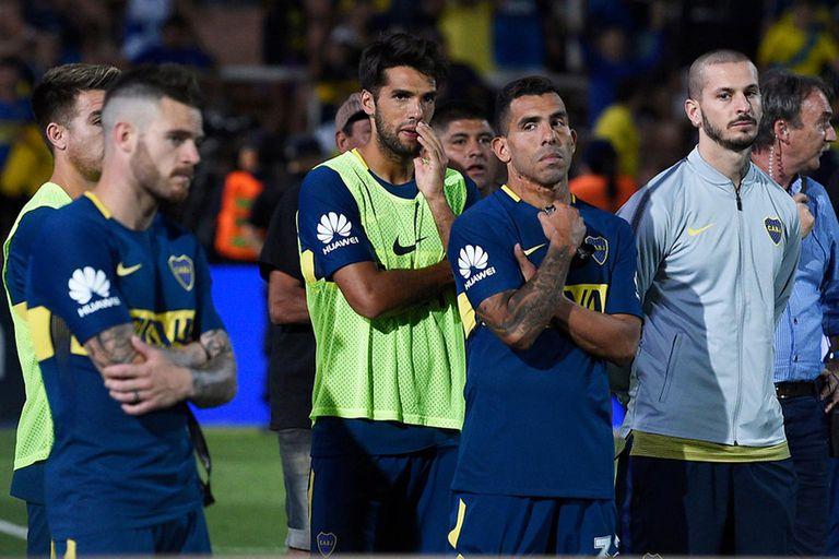 Los rostros de Nández, Tevez y Benedetto, tras la derrota ante River en la final de la Supercopa Argentina de hace un año