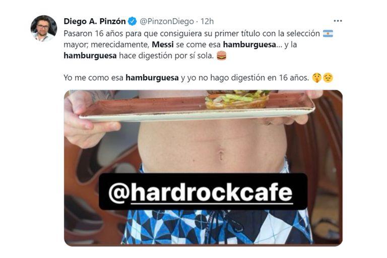 Messi sostiene el plato con la hamburguesa