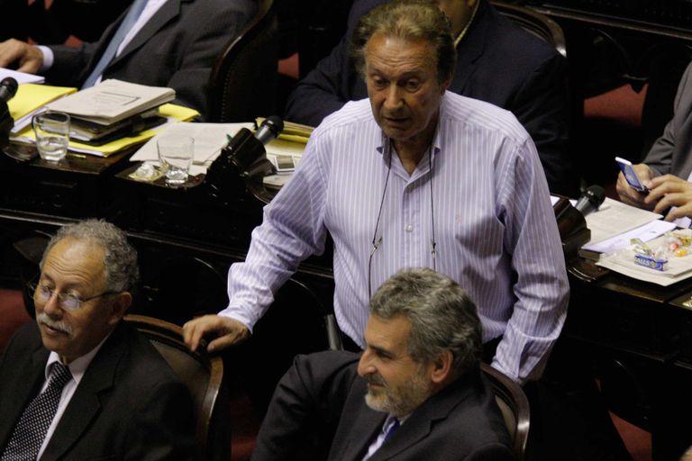 Eduardo Borocó junto a Agustín Rossi