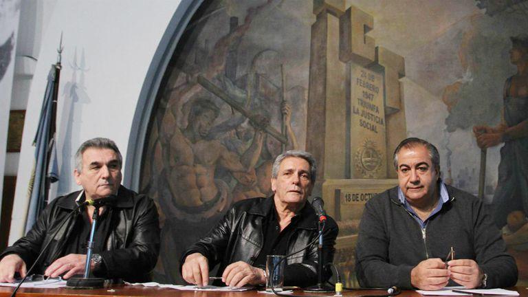 Los líderes de la CGT: Juan Carlos Schmidt, Carlos Acuña y Héctor Daer