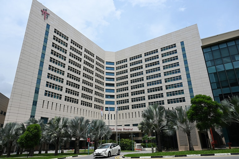 The exterior of Tan Tock Seng Hospital is shown in Singapore on April 30, 2021, as authorities attempted to contain the spread of the coronavirus after an outbreak was detected at the facility.