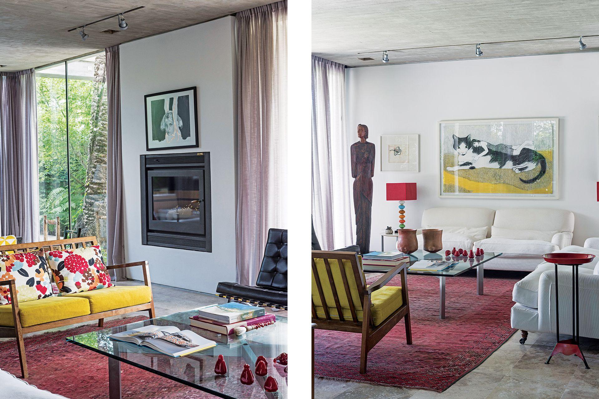 En un segundo living de mayor tamaño, alfombra en tonos rojizos (Facundo Lhez) y banco mid century (Vassily). Cuadro del gato (Viviana Blanco) sobre el sillón 'Raffles' (Gris Dimensión) y mesa ratona de vidrio (Bacano).
