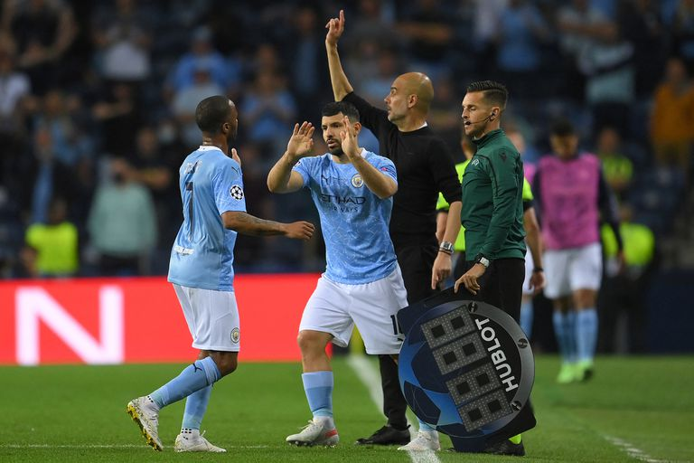 Manchester City's English forward Raheem Sterling (L) is greeted as he leaves the pitch by Manchester City's Argentine forward Sergio Aguero during the UEFA Champions League final football match between Manchester City and Chelsea FC at the Dragao stadium in Porto on May 29, 2021. (Photo by David Ramos / POOL / AFP)