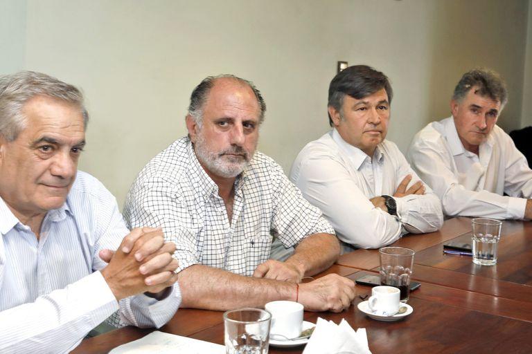 Carlos Iannizzotto (Coninagro), Jorge Chemes (CRA), Daniel Pelegrina (Sociedad Rural) y Carlos Achetoni (FAA), de la Mesa de Enlace