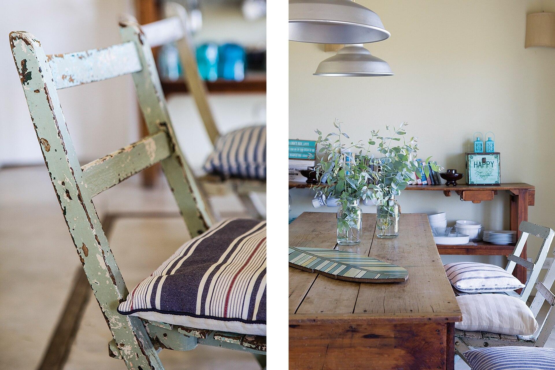 Mesa, sillas decapadas de diferentes colores compradas en remates o en pueblos de la costa. Almohadones (Ana Szarun). Lámparas galponeras. (Huup Iluminación). Tabla traída de un viaje.