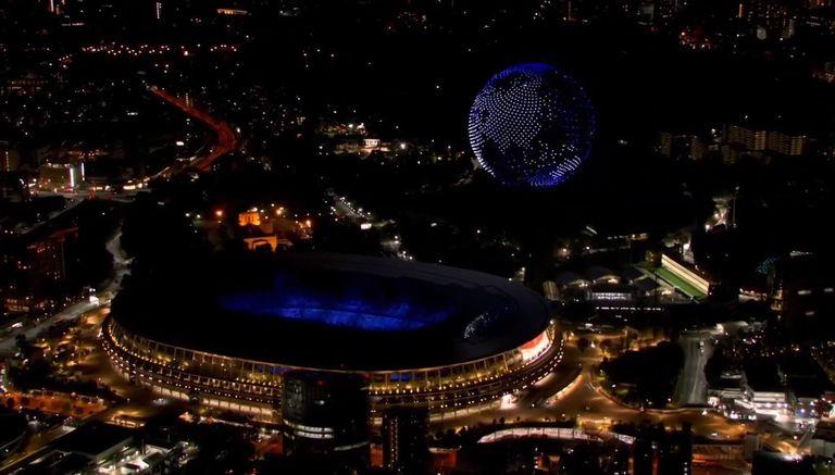 23-07-2021 Drones en el cielo de Tokio formando el planeta Tierra POLITICA INVESTIGACIÓN Y TECNOLOGÍA JUEGOS OLÍMPIOS TOKIO 2020