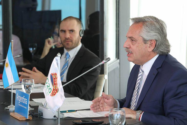 El presidente Alberto Fernández junto a Martín Guzmán.