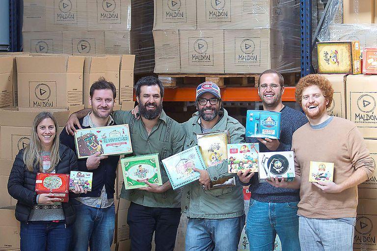 El equipo de Maldón con el dibujante Liniers