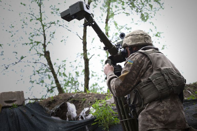 16-05-2019 May 10, 2019 - Avdiivka, Ukraine: An Ukrainian soldier looks through a Russian-made periscope on the front lines. Donetsk People's Republic, Russian, and Chechen flags were seen flying in the three DNR positions in front of this Ukrainian observation post, which ranged from 600 meters to one kilometer away, and a heavy exchange of BMP 30mm and grenade fire, among other ceasefire violations, were heard during the visit. (Daniel Brown/Contacto) POLITICA INTERNACIONAL Daniel Brown