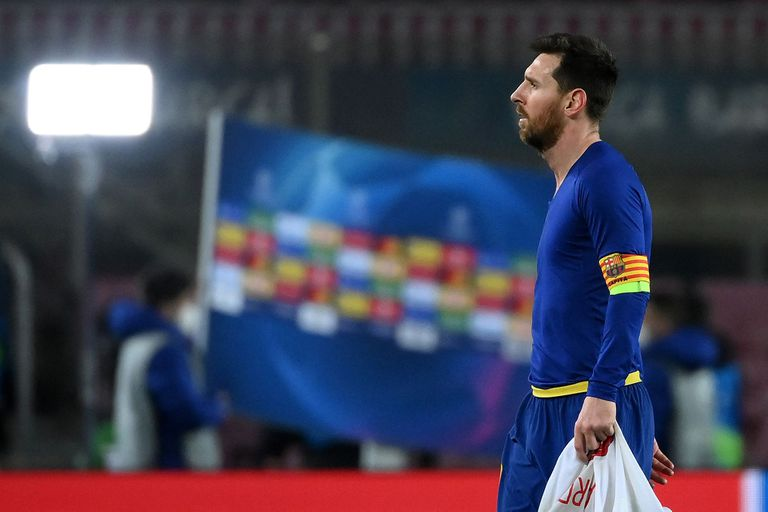 Barcelonas Argentinian forward Lionel Messi walks off the pitch at the end of the UEFA Champions League round of 16 first leg football match between FC Barcelona and Paris Saint-Germain FC at the Camp Nou stadium in Barcelona on February 16, 2021. (Photo by LLUIS GENE / AFP)