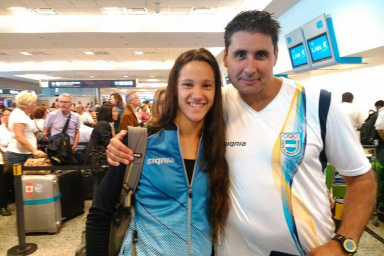 Junto a su entrenador, Federico Rossi