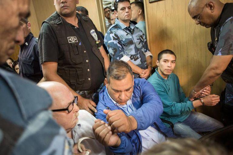 Los acusados antes de escuchar el veredicto