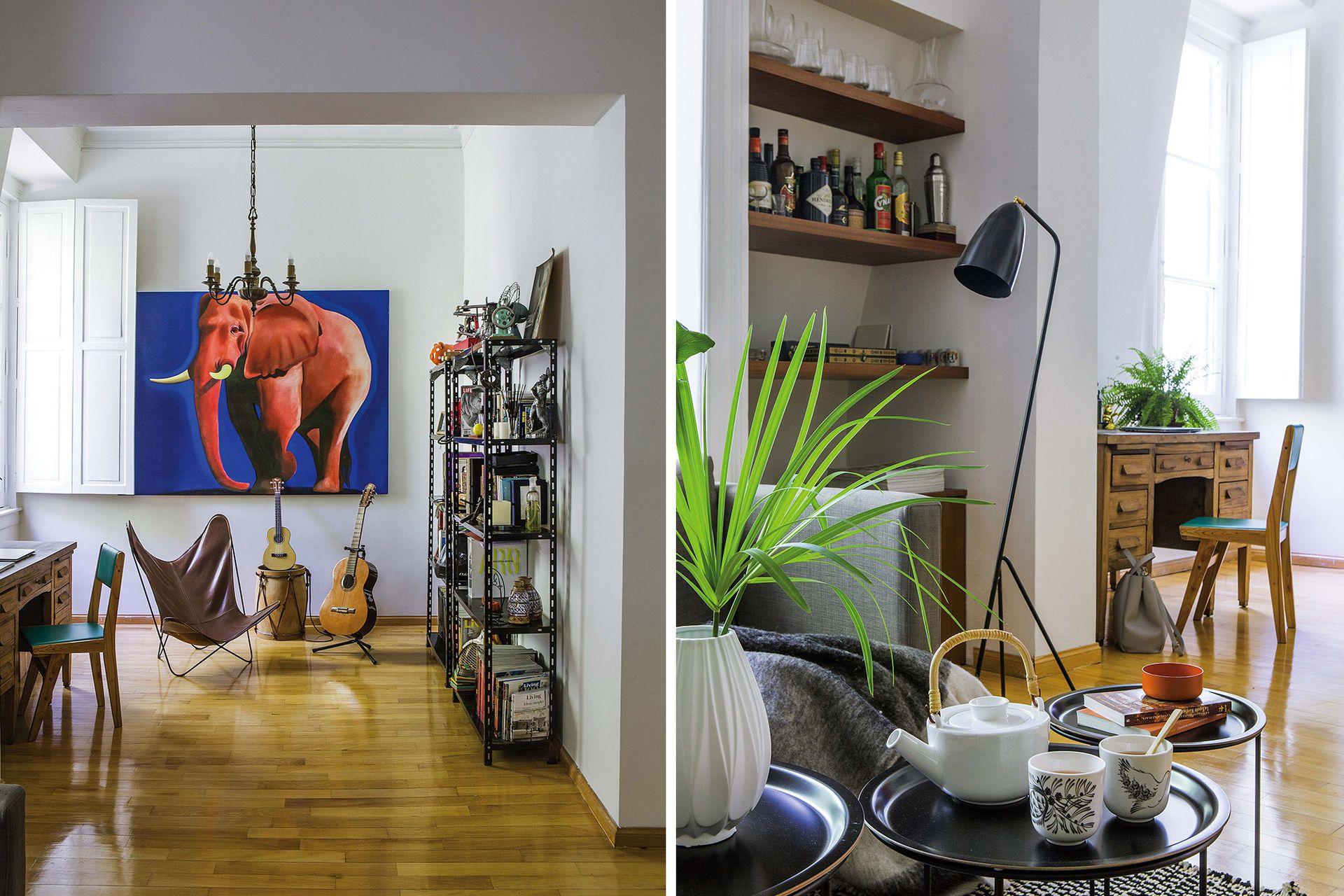 Escritorio vintage, silla nórdica (Mobler). Araña heredada, cuadro de María Casalins. Silla BKF de cuero y biblioteca metálica tipo Rapi-estant.