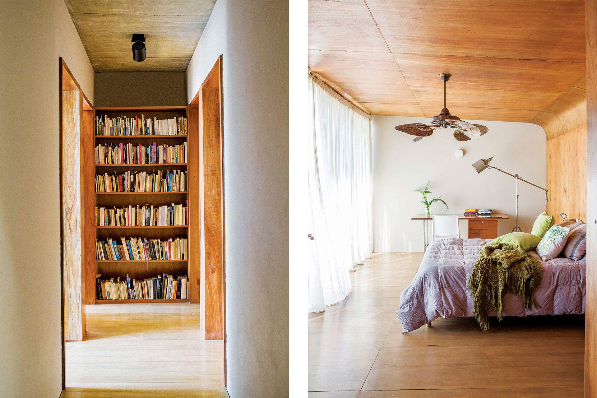 En el pasillo de distribución del último piso, una biblioteca de madera aporta calidez y profundidad a la perspectiva.