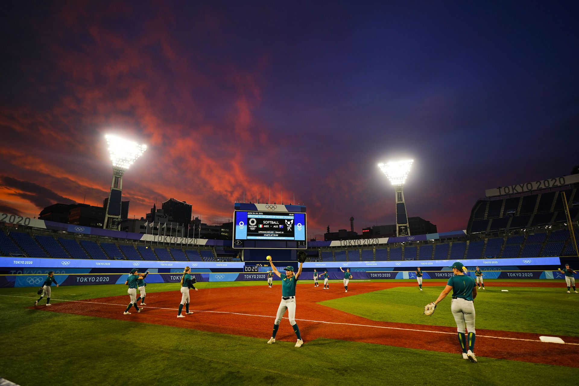 Members of team Australia warm up before a a softball game against Mexico at the 2020 Summer Olympics, Monday, July 26, 2021, in Yokohama, Japan. (AP Photo/Matt Slocum)