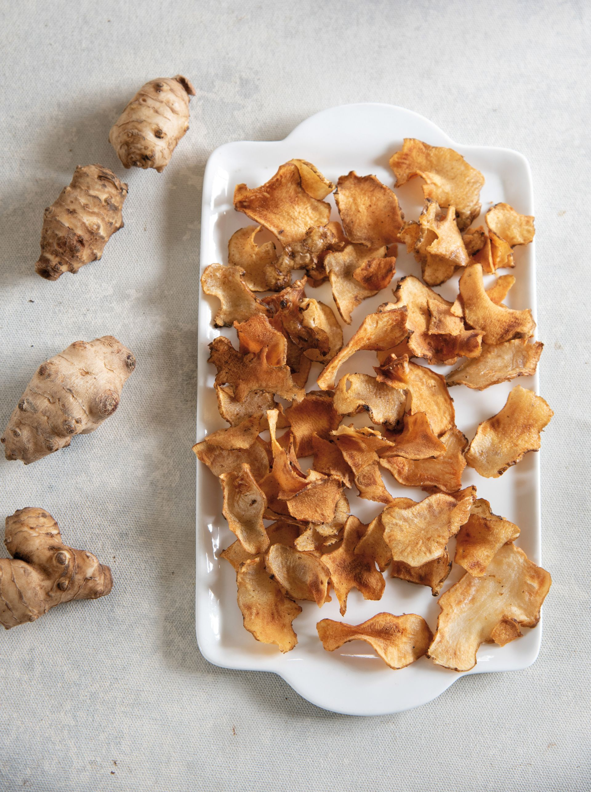 Como snacks o para acompañar picadas, los chips de topinambur son una opción sana a cualquier hora.