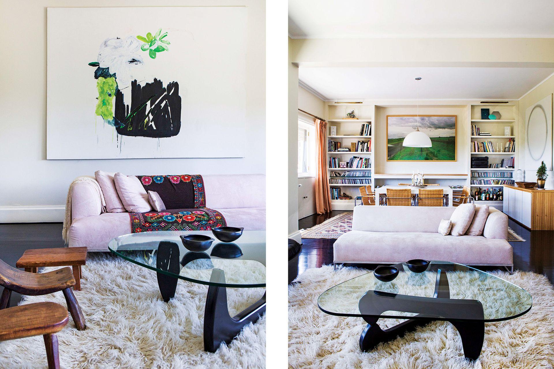 Sillones rosados (Gris Dimensión) con aguayo boliviano y obra de gran formato de la artista Jazmín López. La mesa baja, célebre diseño de Isamu Noguchi. Las sillas de madera forman una colección con varias joyitas, obsequio de amigos artistas.
