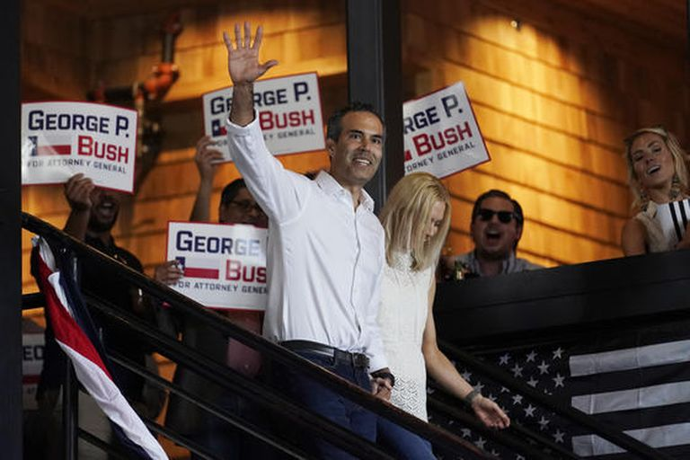 Texas Land Commissioner George P. Bush arrives for a kick-off rally with his wife Amanda to announced he will run for Texas Attorney General, Wednesday, June 2, 2021, in Austin, Texas