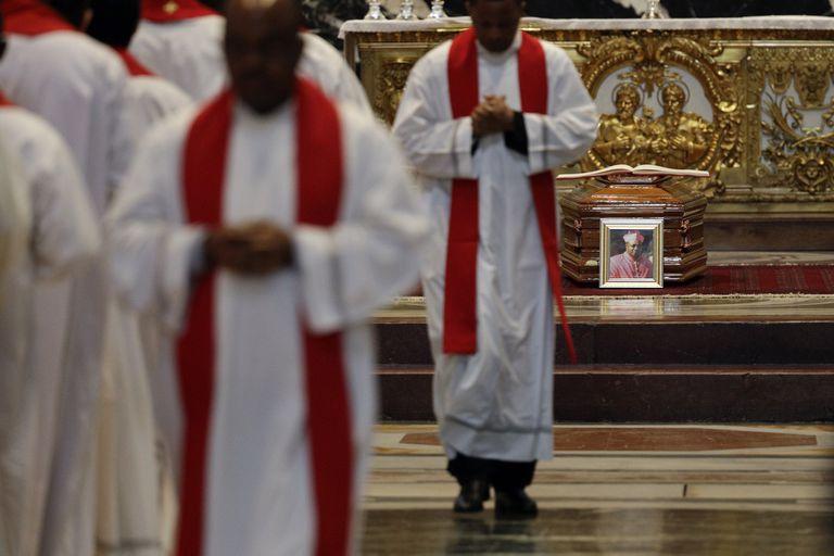 Priests attend the funeral service of Cardinal Leon Kalenga Badikebele, the Apostolic nuncio in Argentina, at St. Peters Basilica at the Vatican, Saturday, June 15, 2019. (AP Photo/Gregorio Borgia)