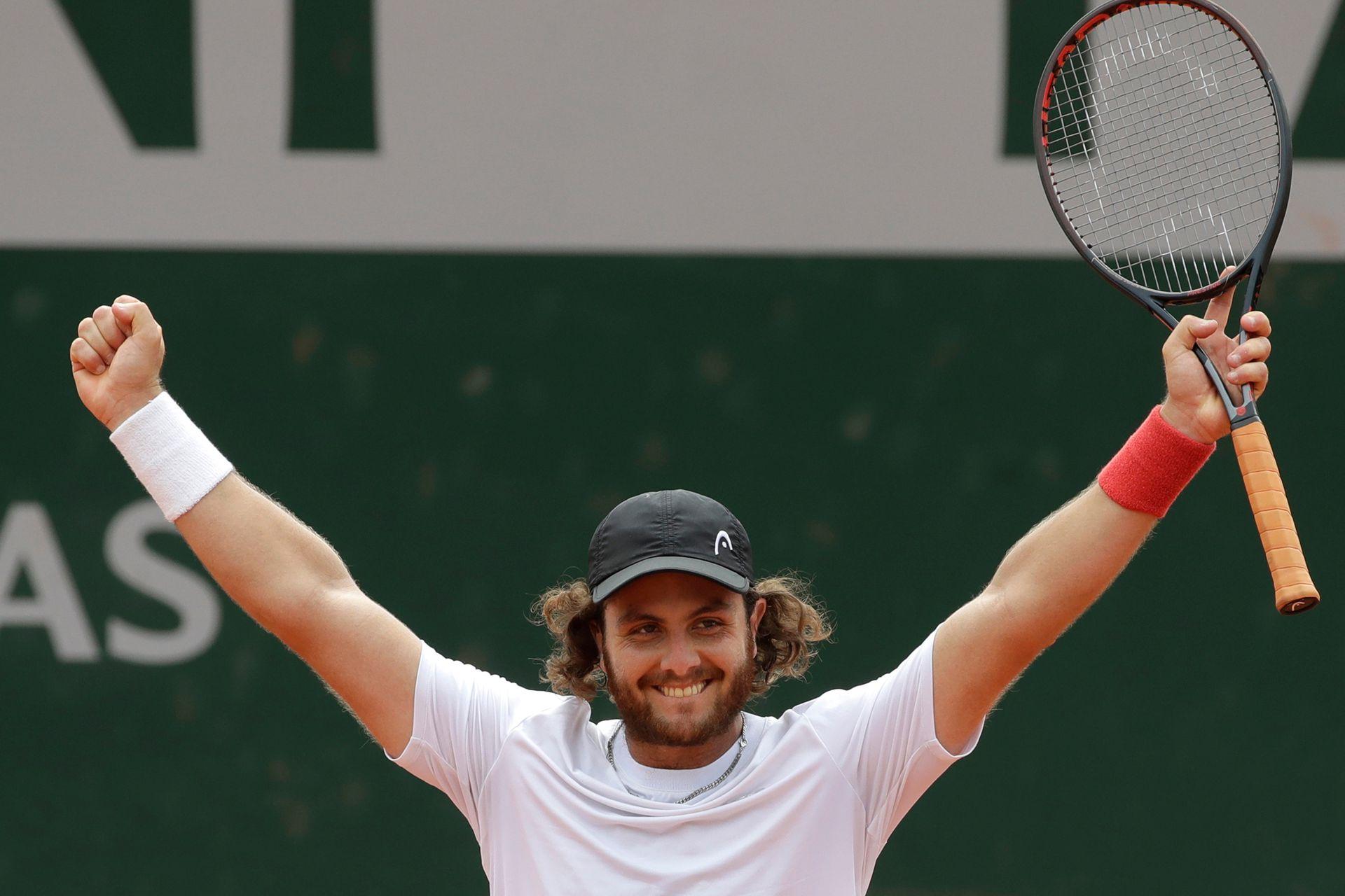 Marco Trungelliti celebra su victoria sobre Bernard Tomic