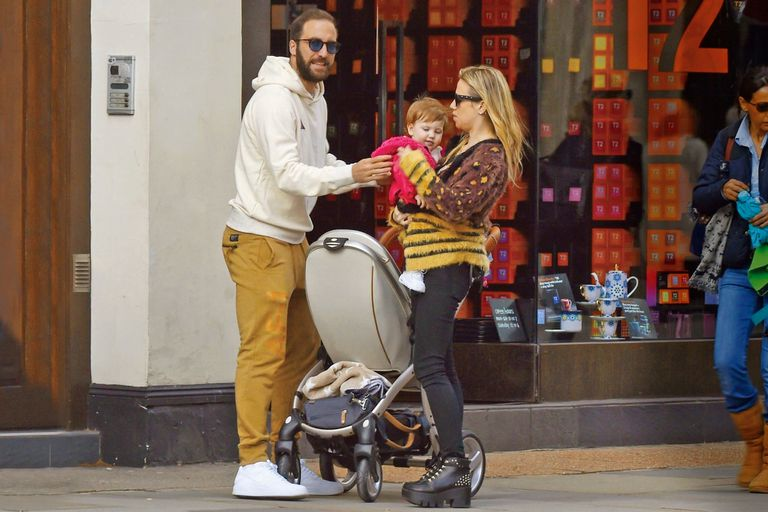 rgentinian and Chelsea striker Gonzalo Higuain seen with model wife Lara Wechsler newborn child for the first time in London. The couple enjoyed the London sunshine as they walked down the Kings Road after he moved from Milan to Chelsea FC in January this year. Pictured: Gonzalo Higuain - Lara Wechs