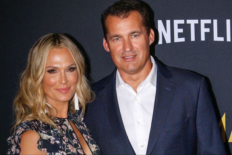 Con su esposa, Molly Sims