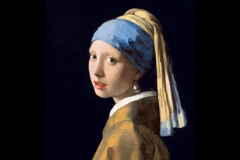 """La chica más famosa de Vermeer no lleva un sombrero rojo ni una flauta, es """"La joven de la perla"""" (también conocida como """"Muchacha con turbante"""")  y convirtió al holandés en un pintor popularmente conocido en los cinco continentes. Está en La Haya"""