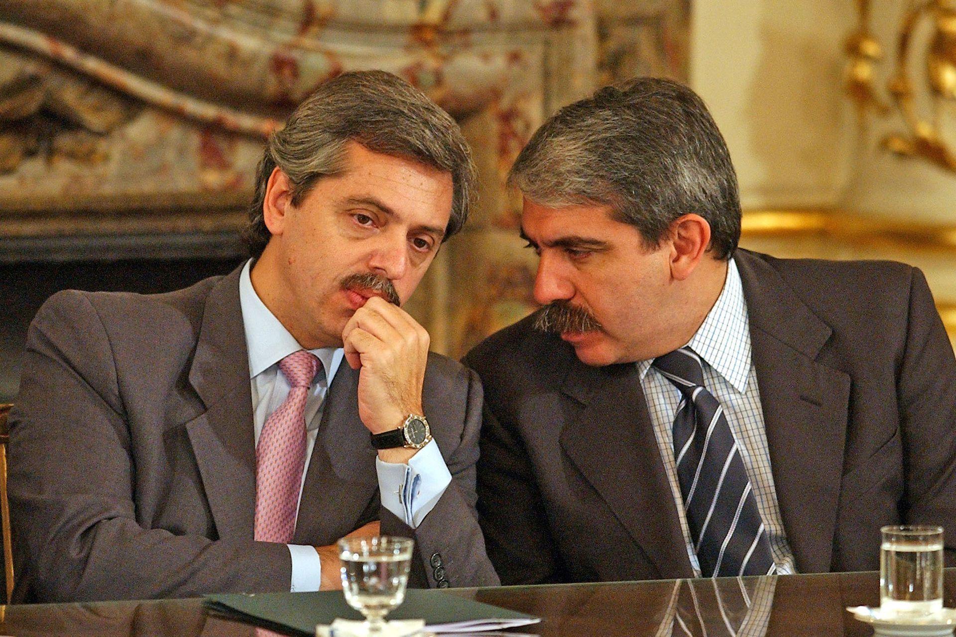Con Aníbal Fernández en un acto en el Salón Blanco de la Casa Rosada (31 de marzo de 2004)