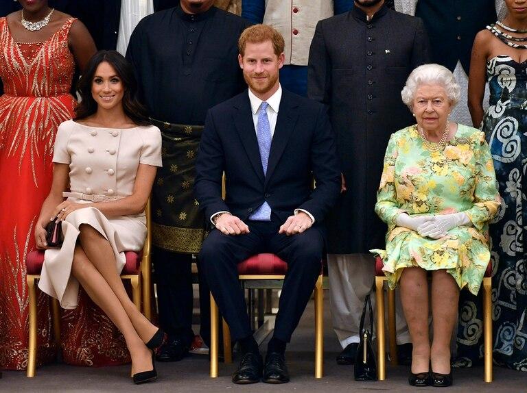 El príncipe Harry, Meghan y la Reina Isabel